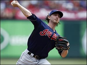 Cleveland Indians starting pitcher Josh Tomlin delivers to the Texas Rangers.