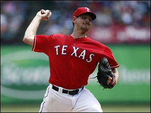 Texas Rangers starting pitcher Nick Tepesch delivers to the Cleveland Indians.