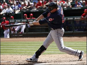 Jason Giambi follows through for a single against the Texas Rangers.