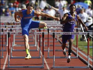 Patrick Henry's Zach Nye, left, competes in the Div. III 110 meter hurdles.