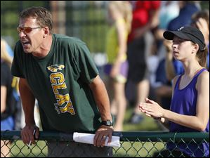 Rod Gyurke encourages his daughter, Clay's Erin Gyurke, in the 3200 meter run.