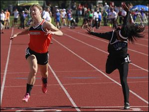 Gibsonburg's Kendall Reynolds, left, places 6th in Div. III 100-meter dash.