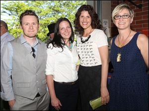 Matt Squibb, left, Jamie Squibb, center left, Dani Fuller, center right, and Michelle Atkinson, all of Sylvania, attended this year's Distinguished Hall of Fame celebration put on by the Sylvania Area Chamber of Commerce and the Sylvania Community Arts Commission at the Historical Village near downtown Sylvania.