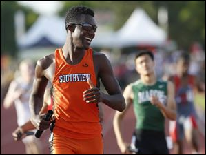 Southview's Jernard Pinckney is all smiles after he and his team placed 3rd in the Div. 1 4x400 meter relay.