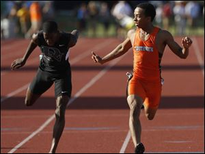 Southview's Malcolm Johnson places 2nd in the Div. 1 200 meter dash.