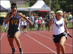 Toledo Christian anchor Micah Johnston and her team places 3rd in the Div. III 4x100 meter relay.