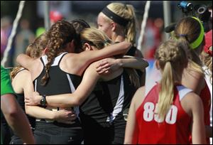 The Perrysburg girls 3200 relay team