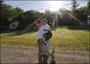 Hunter Gandee, 14, and his brother Braden, 7, begin the trek to Ann Arbor.