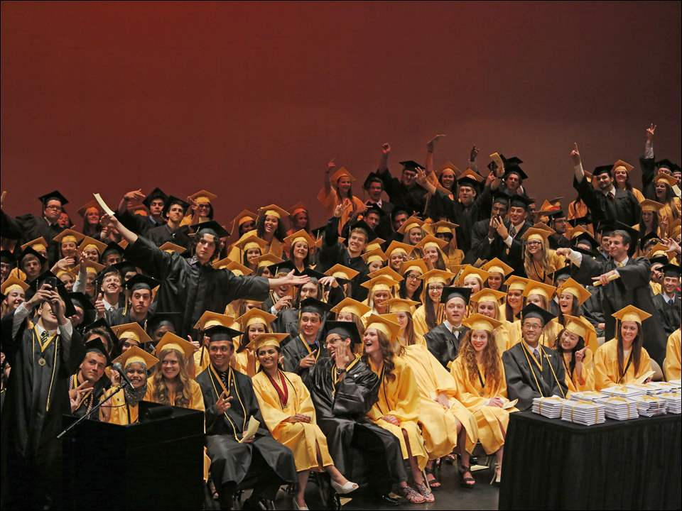 Northview High School salutatorian Dominik Konik, lower left, takes a selfie of himself and his classmates before he begins his address.
