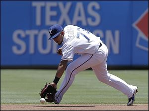 Texas Rangers second baseman Rougned Odor  fields a hit by Cleveland Indians' Michael Brantley.