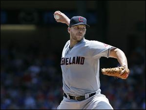Indians starting pitcher Justin Masterson throws against the Texas Rangers.