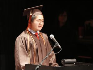 Yuren Chen, the salutatorian of the class, speaks during the ceremony.