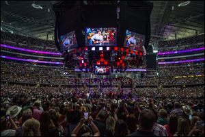 George Strait performs during his farewell tour Saturday at AT&T Stadium in Arlington, Texas.