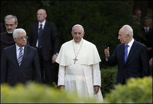 Pope Francis, Israel's President Shimon Peres, right, and Palestinian President Mahmoud Abbas, left, pray for peace today at the Vatican.