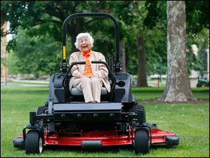 Trudy Price sits on the motorized Toro Lawn Mower on the Bowling Green University Hall lawn in celebration of her 100th birthday.