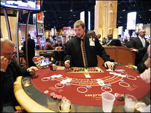 Greg Stockard deals cards at a blackjack table at Hollywood Casino Toledo, which posted revenue of $16.2 million in May.