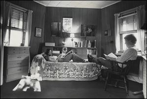 Beth and Frank Luchsinger in their third-floor bedroom of the windmill house in Bowling Green in June, 1977.