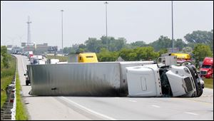 Authorities respond to an overturned truck on I -75 southbound near the Stickeny Avenue exit.