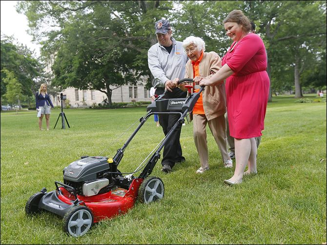 CTY mowerSterling House of Bowlin Sterling House of Bowling Green resident Trudy Price gets her birthday wish by mowing the Bowling Green University Hall lawn in celebration of turning 100. Giving her hand with the yard work on Monday is Scott Euler and Christine Burger.