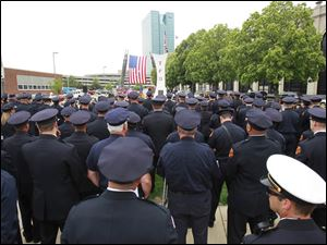 A multitude of police officers and firefighters attended the Toledo Fire Department's annual memorial service.