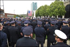A throng of police officers and firefighters look on during the annual memorial service in Chub DeWolf Park.