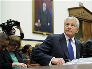 Defense Secretary Chuck Hagel arrives on Capitol Hill in Washington to testify before the House Armed Services Committee.