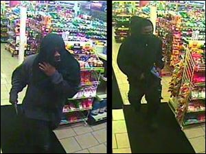 Surveillance video images showing two men sought by police in multiple robberies.