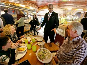 Carnival Corp. CEO Arnold Donald talks with passengers aboard the Carnival Splendor cruise ship as he takes over a troubled, family-run business and trying to convert the world's largest cruise line into a profitable venture. The past two years have been troublesome for the cruise line.