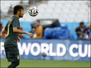 A member of Brazil's soccer team practices in Sao Paulo, where World Cup play will begin  today.