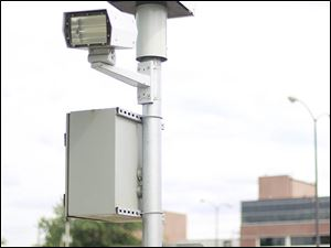 A red light speed camera sits near Cherry Street and Delaware Avenue in Toledo.  This is the second time the Ohio Supreme Court will consider the constitution-ality of the program.