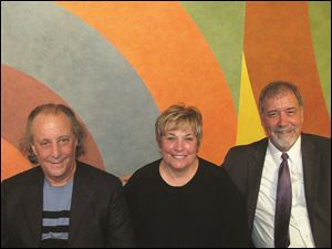From left, Stuart and Maxine Frankel, and Martin Porter in front of a Sol LeWitt mural.