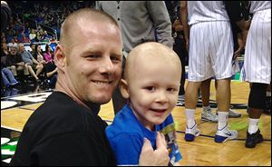 Joshua Chambers, a 4-year-old boy with leukemia, with his father, Jeremy, who grew up in Perrysburg.
