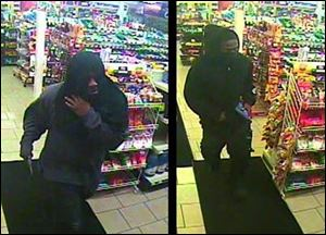 Police released surveillance photos of the two masked, armed men at Stop & Go at 1409 Western Ave. This holdup was Tuesday night.
