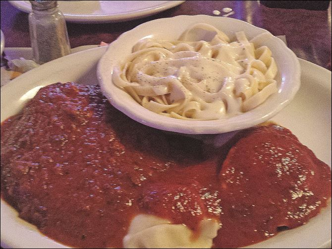 The combo plate at Jo-Jo's includes chicken Parmesan. The combo plate at Jo-Jo's includes chicken Parmesan.