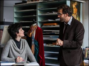 Juliette Binoche and Clive Owen  in a scene from '‍Words and Pictures.'