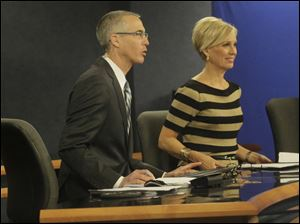 WTVG-TV, Channel 13, co-anchors Lee Conklin and Diane Larson address their viewers during a broadcast at their studio.