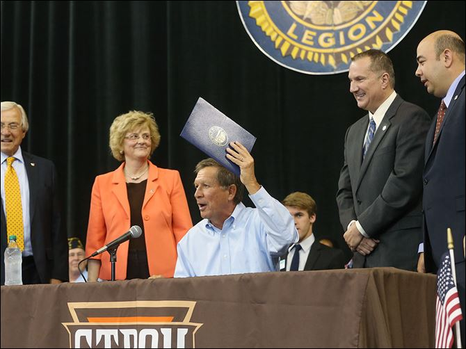 n6boysstate Gov. John Kasich, center, performs a ceremonial signing of House Bill 484  with state and local officials, from left, former Bowling Green State University trustee J. Robert Sebo, BGSU President Mary Ellen Mazey, state Rep. Tim Brown (R., Bowling Green), and state Rep. Cliff Rosenberger (R., Clarksville, Ohio). The law, officially signed last week, changes the state funding formula for two-year colleges to a performance-based model similar to one passed for four-year schools last year.
