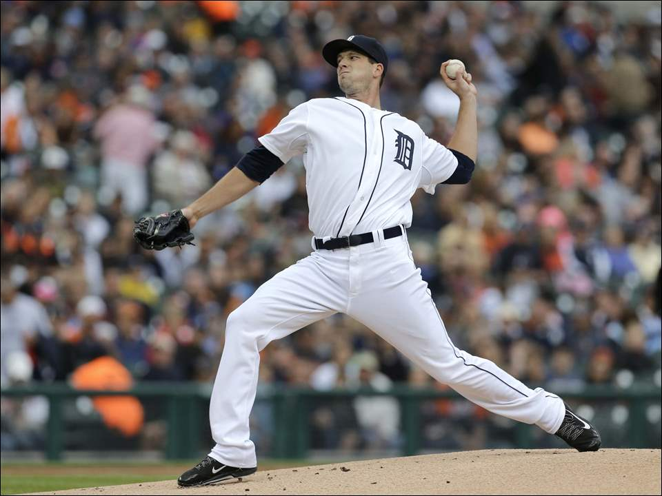 Detroit Tigers pitcher Drew Smyly throws against the Minnesota Twins.