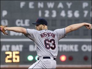 Cleveland Indians starting pitcher Justin Masterson delivers to the Boston Red Sox.