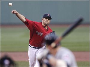 Boston Red Sox starting pitcher John Lackey delivers a pitch to the Cleveland Indians.