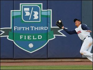 Toledo Mud Hens CF Ezequiel Carrera makes a play against the Buffalo Bisons.