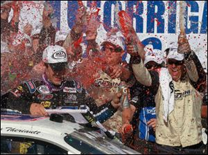Austin Theriault is sprayed with Gatorade at Victory Lane after winning the race.