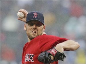 Boston Red Sox starting pitcher John Lackey delivers to the Cleveland Indians.