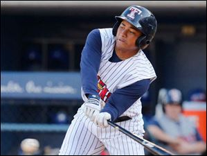 Mud Hens CF Ezequiel Carrera hits the ball against the Buffalo Bisons.