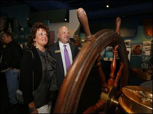 Dawn and Gary Sartain look at a wheel from the Tashmoo during the opening reception for the National Museum of the Great Lakes, April 25, 2014.