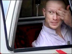 Sgt. Bowe Bergdahl, sits in a vehicle guarded by the Taliban in eastern Afghanistan in a video from the Voice of Jihad Web site.