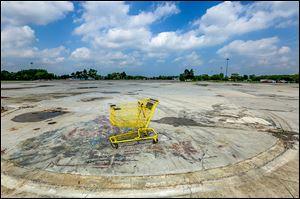 A shopping cart occupies a spot at the site of the demolished North Towne Square Mall along Alexis Road.