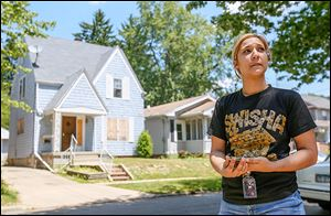 For the last two years, when Tiffany Bolczak, 26, looks out the kitchen window of her Talbot Street home in West Toledo, she sees a boarded up, vacant house. 'It's really terrible,' she says.