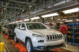 Fully assembled Jeep Cherokees roll along the line at the Toledo Assembly complex. Chuck F. Padden, plant manager, said: '‍[This facility] will be one of the largest manufacturing sites in North America with both plants running full tilt,'‍ referring to the two Jeep models built there, the Wrangler and the new Cherokee.