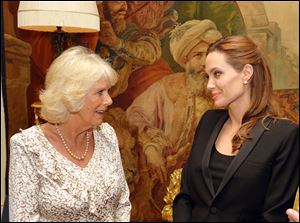 Camilla, Duchess of Cornwall, left, meets Angelina Jolie, as the actress talked about her campaign against sexual violence in war zones during a meeting, at Clarence House, London.